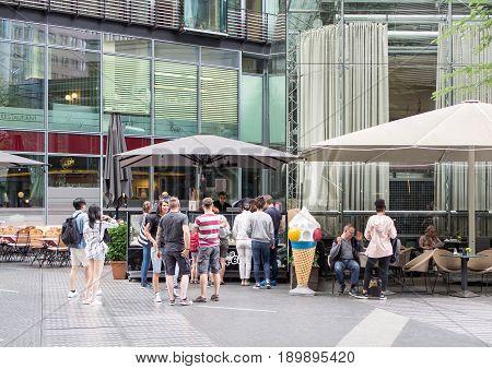 BERLIN GERMANY - JUNE 5 2017: Tourists At An Ice Cream Shop At Potsdamer Platz In Berlin
