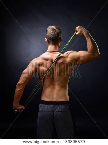 Young Bodybuilder With Expander