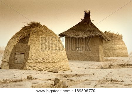 Mali West Africa - Peul village and typical mud buildings with barns for cereals Fulani popolations