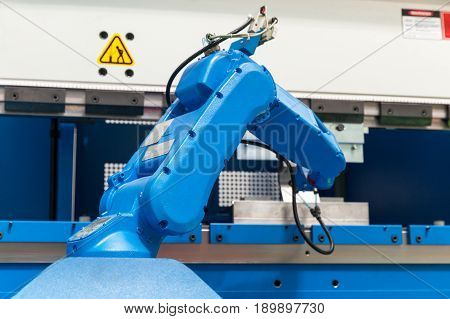Industrial robotic arm. Assembly, machine tending, part transfer, pick and place robot.
