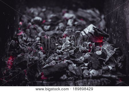 Smouldering coals at night , Decaying charcoal, barbeque season