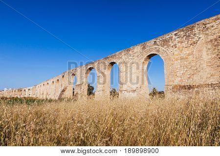 Kamares Aqueduct, Bekir Pasha Aqueduct. Larnaca, Cyprus. Sunset Panorama Landscape