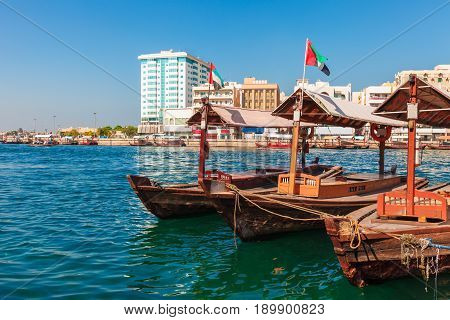 Piers Of Traditional Water Taxi Boats In Dubai, Uae. Panoramic View On Creek Gulf And Deira Area. Fa