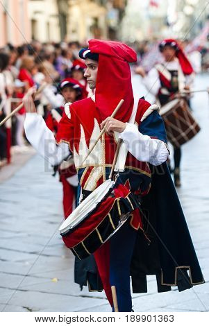 Asti, Italy - September 19, 2010: Drummer in the historic Medieval parade of the Palio. The Palio is a horse race in Italy. Riders on horses without saddles represent the district of the city.