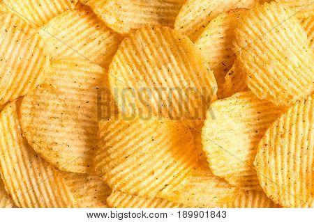 Potato chips texture background. Potatoes pattern.. Chips texture studio photo