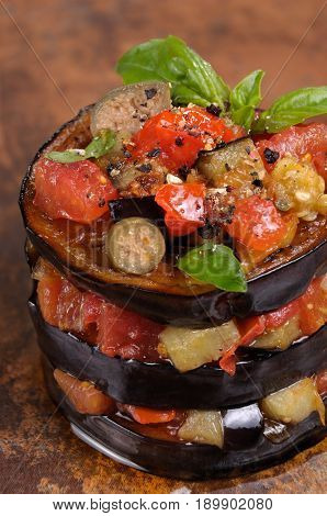 Appetizer fold a pile fried eggplant with tomatoes capers flavoured spices