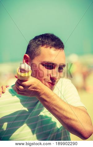 Diet food sweets summer pleasures concept. Happy man woman holding ice cream about to eat it.