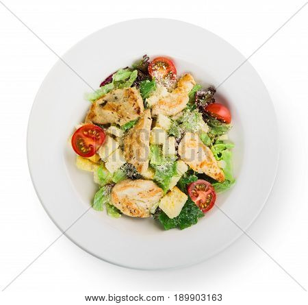 Restaurant food, caesar salad, isolated at white plate, top view