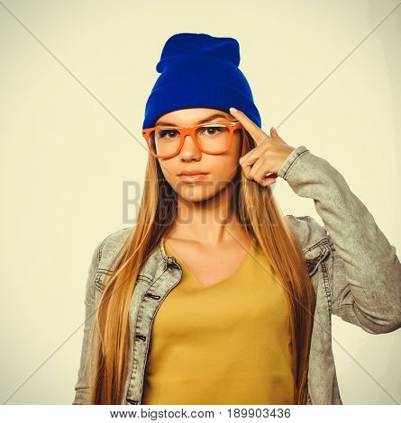Young cute smiling  hipster girl on white background