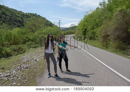 Travel adventure and hiking activity. Active hikers. Hiking sticks near me - hitchhiking