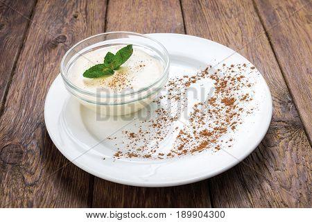 Restaurant food - italian panna cotta with mascarpone or ricotta cheese dessert on wood