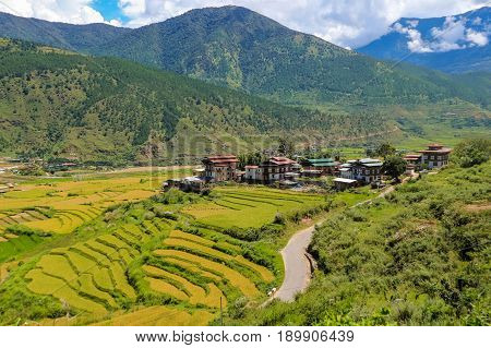 Bhutan Punakha panoramic view of valley from Lobesa towards Wangdue Phodrang. Rice crops between the rivers Pho Chhu and Mo Chhu.