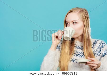 Blonde Woman Drinking Hot Drink From Cup