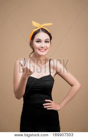 Beautiful Woman Pinup Style Portrait. Asian Woman Hands Gesture