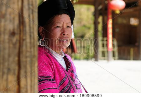 LONGSHENG PING AN CHINA - 10 NOVEMBER 2010: Portrait of the woman from long hair women of the Yao ethnic minority in the guangxi province