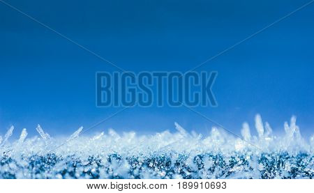 winter background with glittering ice crystals with copy space macro photos. shallow depth of field