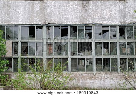 Old abandoned industrial building with broken windows
