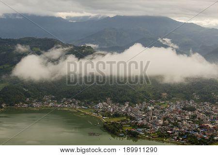 Famous tourist view of Phewa lake and Annapurna mountain range from World Peace Pagoda in Pokhara Nepal