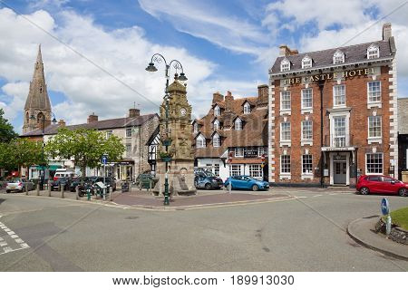 Ruthin Wales UK - June 4 2017: Saint Peters Square in Ruthin with it's historic buildings including the Castle Hotel Peers Memorial clock tower and Myddleton Arms nicknamed the Seven Eyes