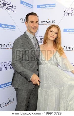 LOS ANGELES - JUN 3:  James Van Der Beek, Kimberly Brook at the 16th Annual Chrysalis Butterfly Ball at the Private Estate on June 3, 2017 in Los Angeles, CA