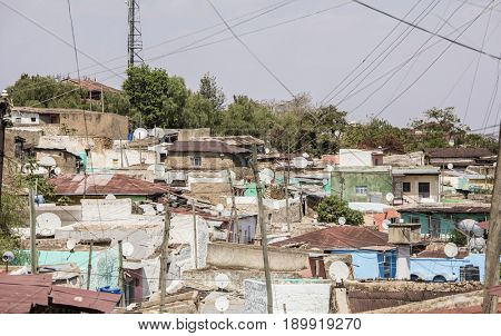 Old town in Ethiopia cluttered with tv dishes and power lines