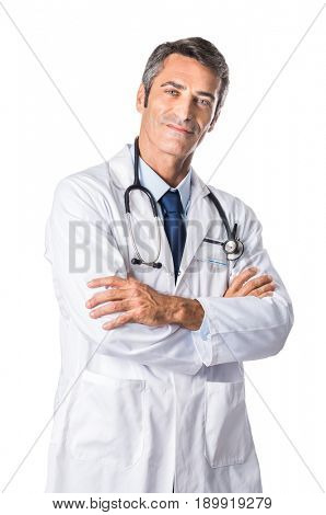 Confident mature doctor with folded arms isolated on white background. Smiling senior doctor in white lab coat and stethoscope looking at camera. Portrait of reliable senior doctor.