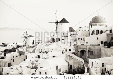 Traditional Oia windmills in Santorini sepia toned black and white photo
