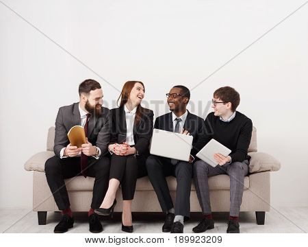 Happy team. Business people laugh, manager introducing new office worker to colleagues