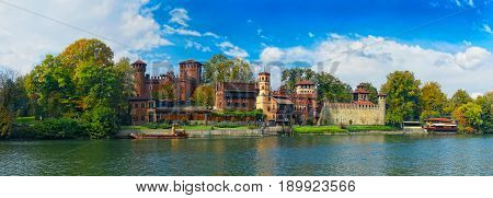 Beautiful panoramic view on antique castle Borgo Medioevale city garden park, Turin city garden across river Po. Italy holidays vacations famous sightseeing tours. Italy Italian architecture