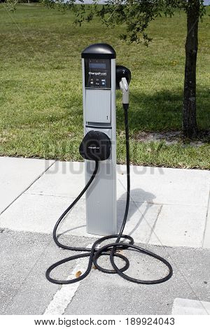 Fort Lauderdale FL USA - May 16 2017: Electric vehicle charging station by ChargePoint outside on a sunny day. Technology to recharge electric vehicles