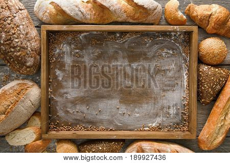 Bread bakery frame background, wooden tray top view with copy space