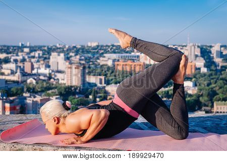 Portrait Of Beautiful Blonde Strong Woman In Sportwear Doing Workout Yoga Exercise And Stretching On
