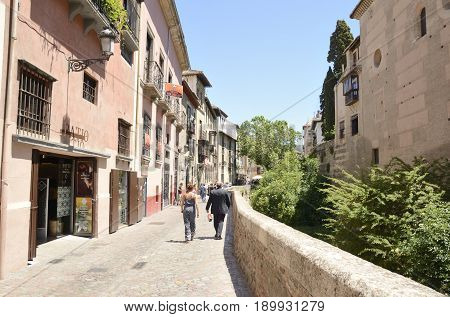 GRANADA, SPAIN - MAY 20, 2017: People walking by one of the most scenic walks named