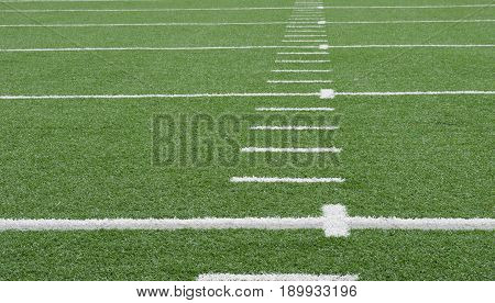 American football with white yard markers. Copy space.