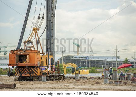 Machine for piling. Construction machinery on the site for the construction of a warehouse