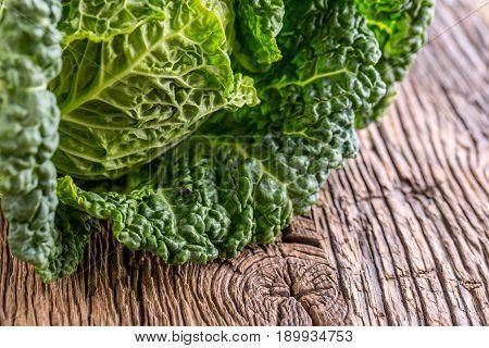 Kale Fresh kale on rustic oak table.