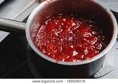 Boiling Strawberry Puree In A Saucepan