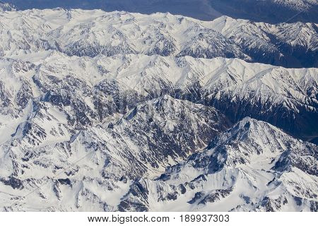 Aerial views in Tibet fly over to mountain Himalaya . View from the plane window