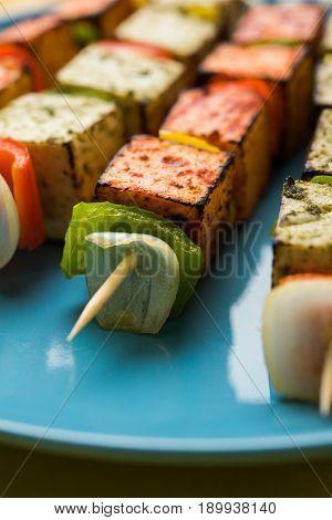 Paneer Tikka Kabab - Tandoori Indian cheese skewers or barbecue paneer, selective focus