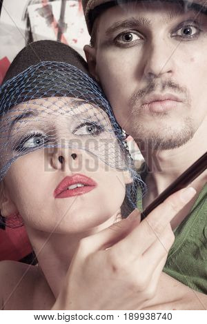 Studio portrait of young man and woman dressed in retro style