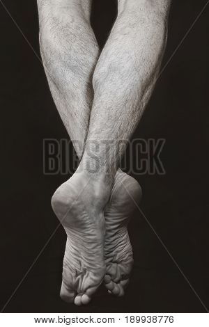 Barefooted male legs standing on tiptoe. Dance Art