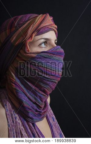 Portrait of a beautiful young woman wearing a hijab. Arabic style women's clothing