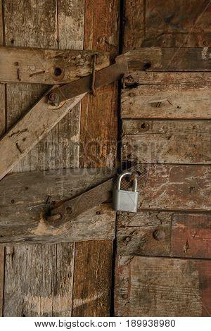 Old locked wooden door with a lock
