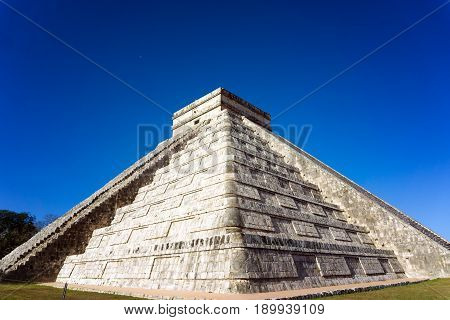 View of the pyramid known as El Castillo in the Mayan ruins of Chichen Itza in Mexico
