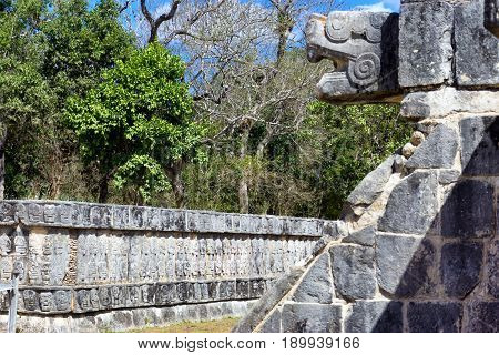 Platform of the skulls in the ancient Mayan city of Chichen Itza in mexico