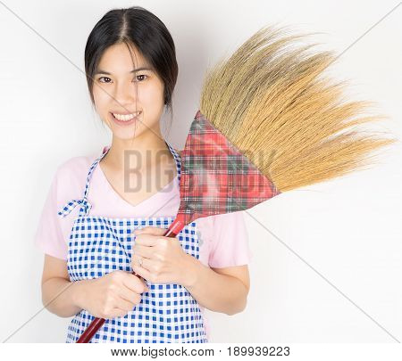 Asian Maid holding a broom ready to work