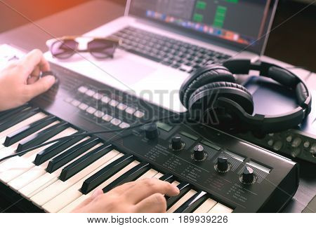 Music Producer is recording Music onto a laptop