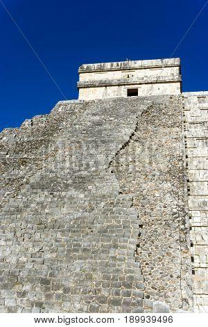 Vertical view of the El Castillo pyramid in the ancient Mayan ruins at Chichen Itza Mexico
