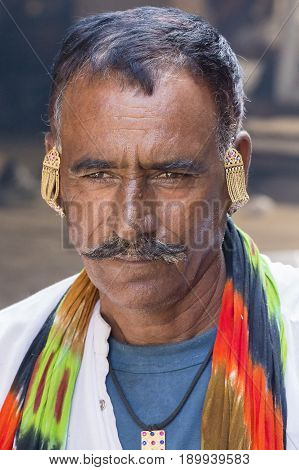 PUSHKAR INDIA - OCTOBER 28 2014: Unidentified Indian man attended the annual Pushkar Camel Mela. This fair is the largest camel trading fair in the world.