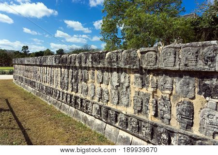 Platform of the skulls in the ruins of Chichen Itza Mexico